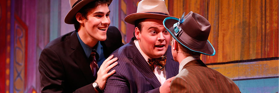 Three theater students performing in Guys and Dolls