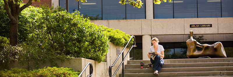 Girl sitting on Ablah Library steps